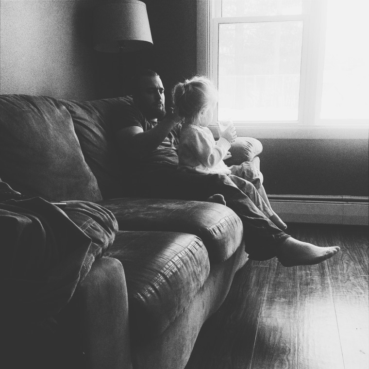 Cuddleing with her uncle - natural intuition photography