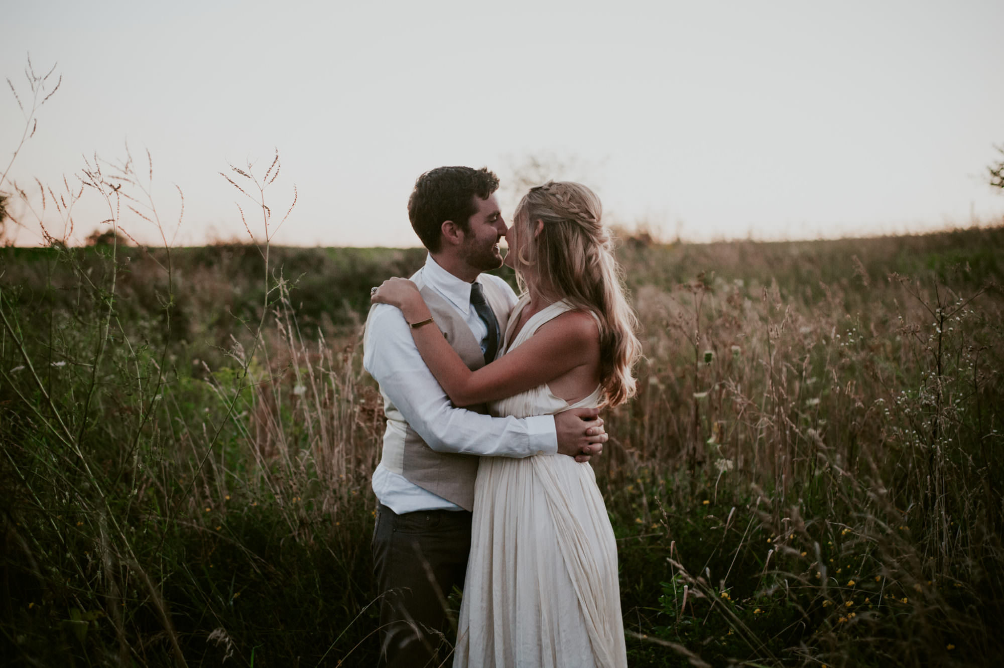 Couple in a Field on Farm on Wedding Day - Natural Intuition Photography