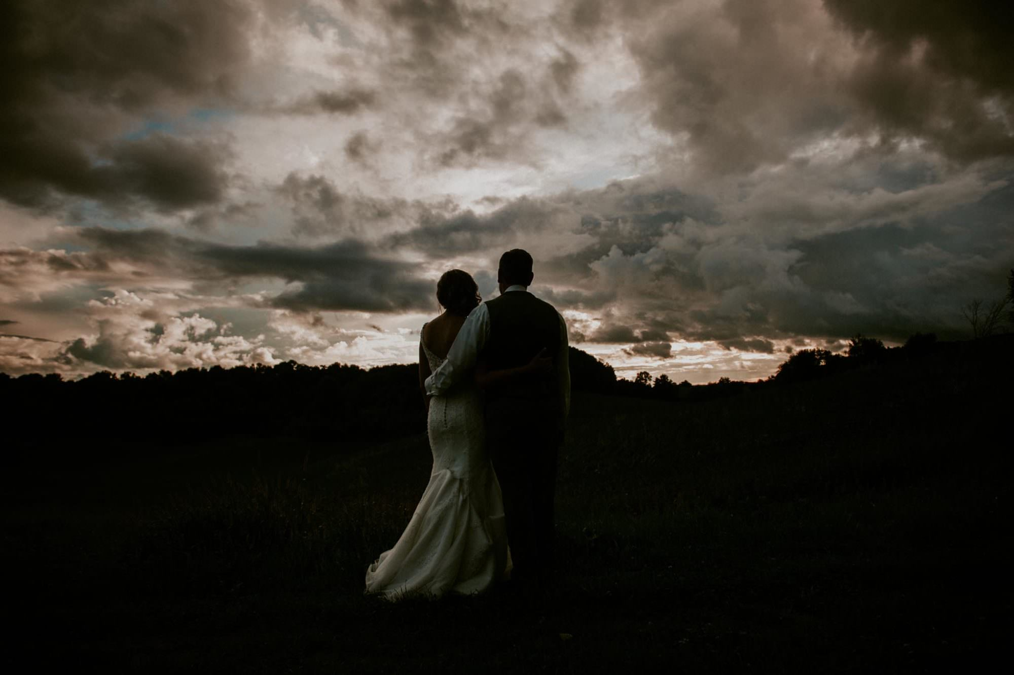 couple at sunset at winery wedding natural intuition photo