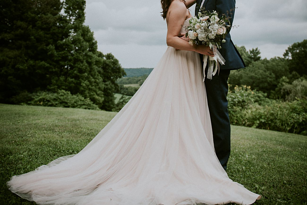Bride and Groom Photos, Couples photos on wedding days, Stormy sky's, Blush wedding gown, Backyard Hilltop Wedding in Spring Green Wisconsin, Madison WI Wedding Photographer