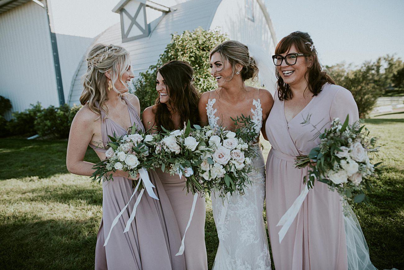 Bride with Bridesmaid, Lace Wedding Dress, Century Barn Mt Horeb Wisconsin Wedding, AC Hotel Madison WI, Barn Weddings, Madison WI Wedding Photographer