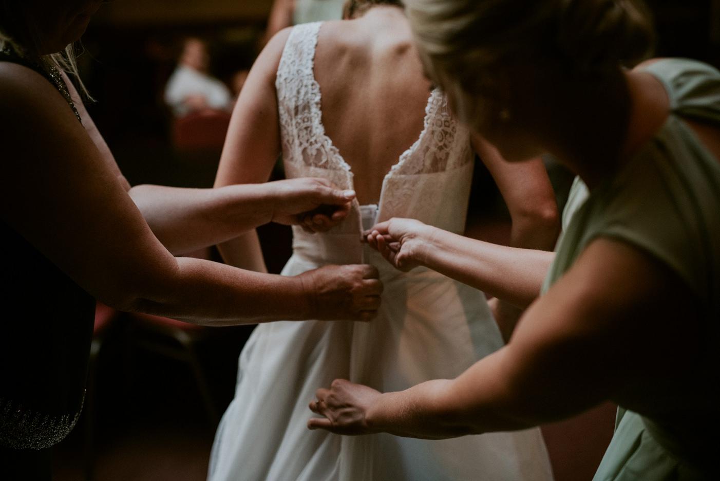 Getting Ready photos in a Church basement - La Crosse WI WEDDING PHOTOGRAPHER