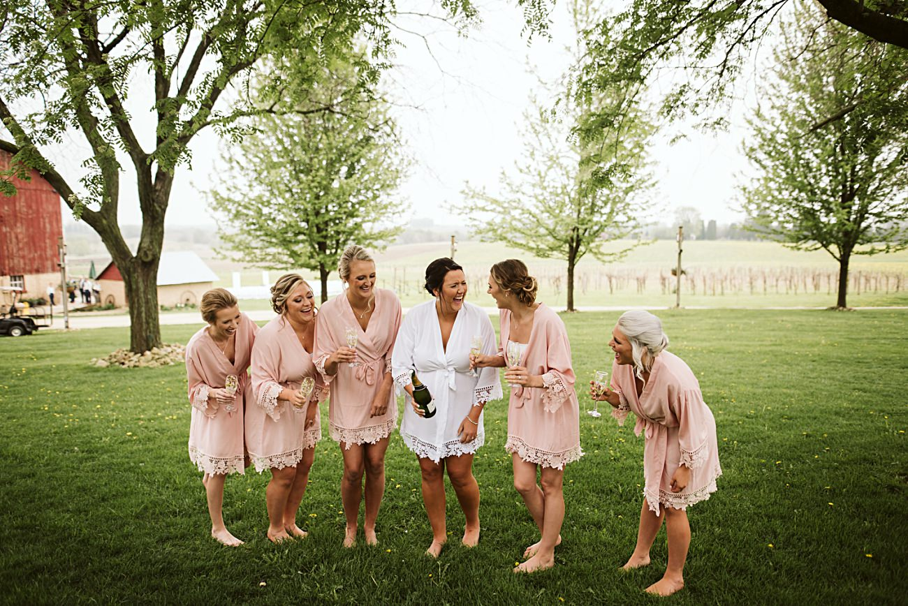 Bride with Bridesmaids, pink robes, Vineyard Wedding, Barn Wedding In Wisconsin, Over the Vines Wedding, Bride and Groom in field, Natural Intuition Photography, Madison Wisconsin Wedding Photographer