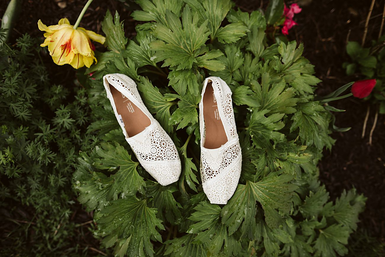 Wedding Shoes, Tom Shoes, Vineyard Wedding, Barn Wedding In Wisconsin, Over the Vines Wedding, Bride and Groom in field, Natural Intuition Photography, Madison Wisconsin Wedding Photographer